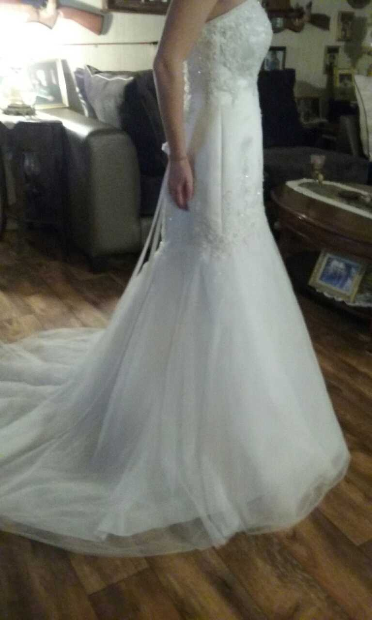 Letgo david 39 s bridal wedding gown in potwin ks for How to sell wedding dress never worn
