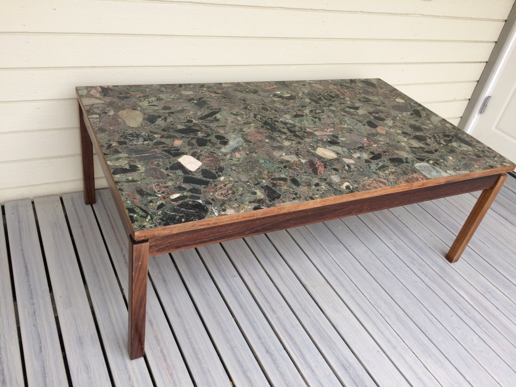 brown wooden framed black and gray marble top table