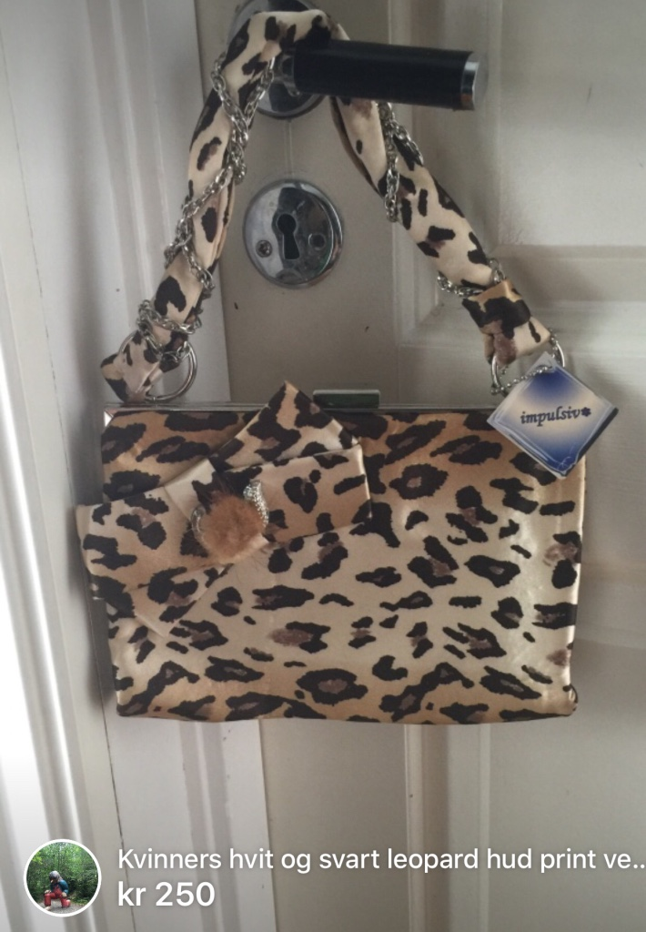white and black leopard printed handbag