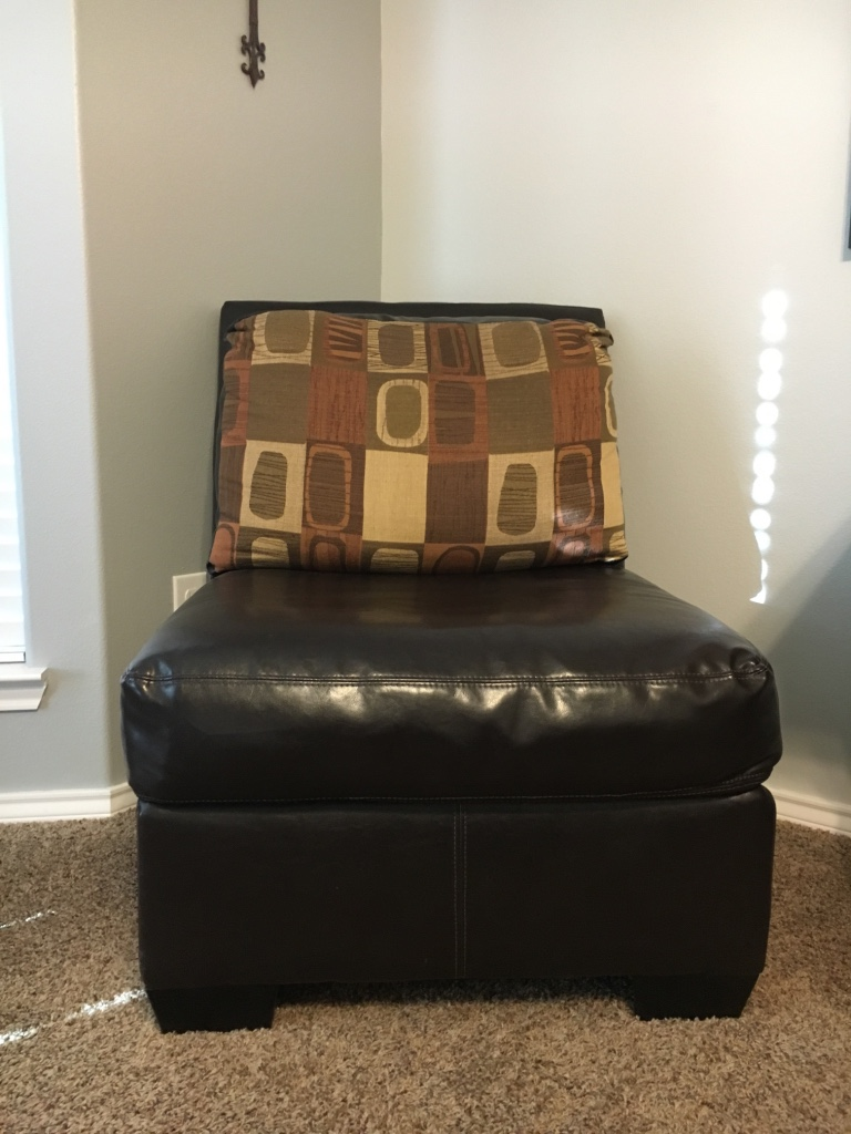 letgo Dark brown leather padded chair in Lubbock TX
