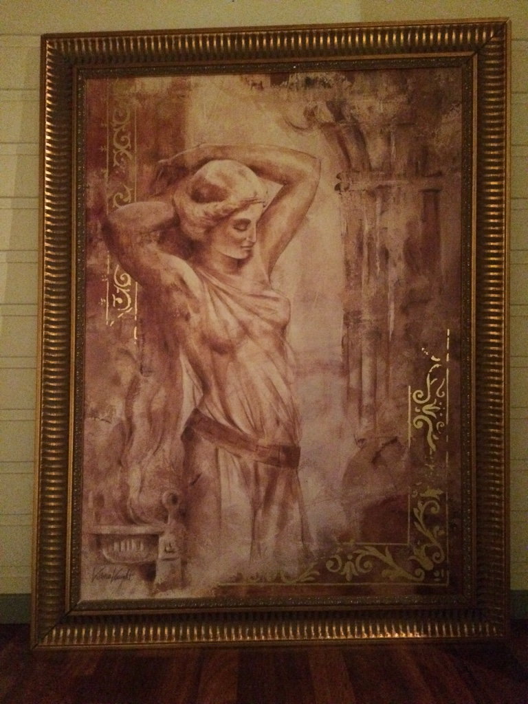Brass framed painting of woman